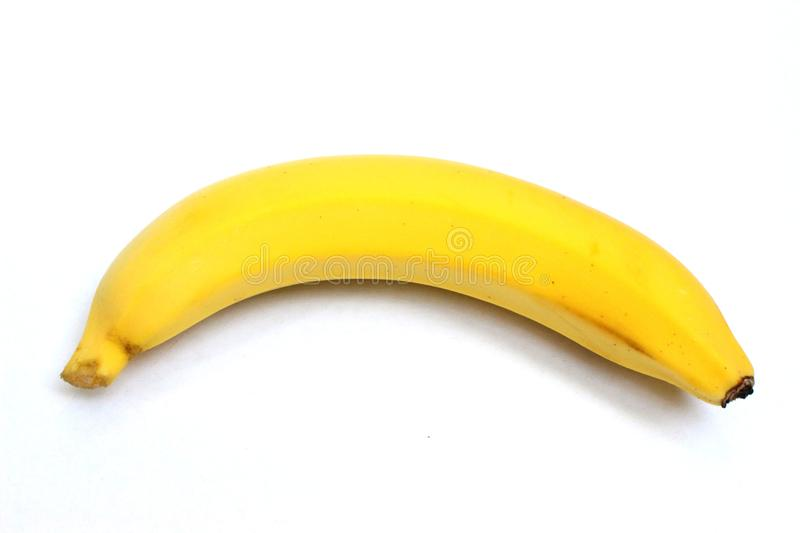 One yellow banana on top view in white background royalty free stock image