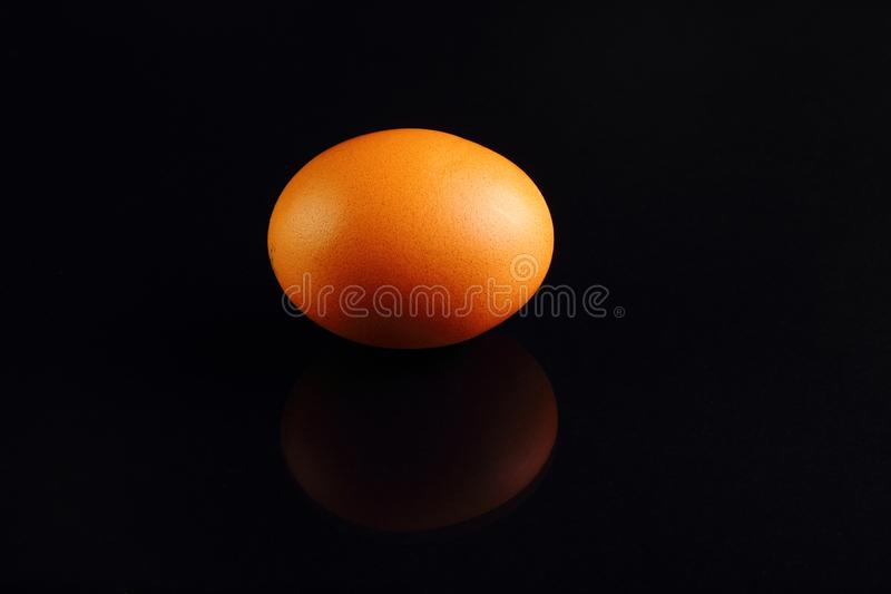 One yellow chicken egg on a black background. Turkey royalty free stock photo