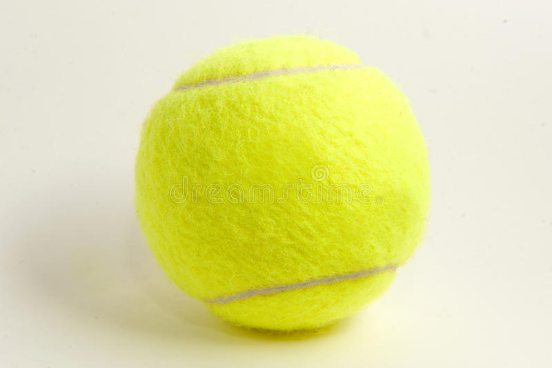 One yellow felt tennis ball royalty free stock photography