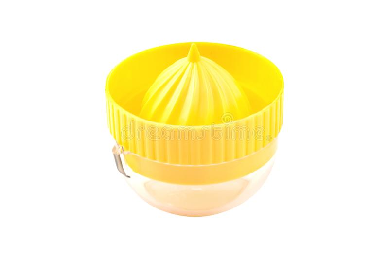 One yellow plastic juicer with transparent tank for make fresh natural juice from different fruits and vegetables isolated. On white stock photography