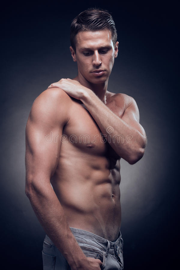 One young adult man, Caucasian, fitness model, muscular body, sh stock image