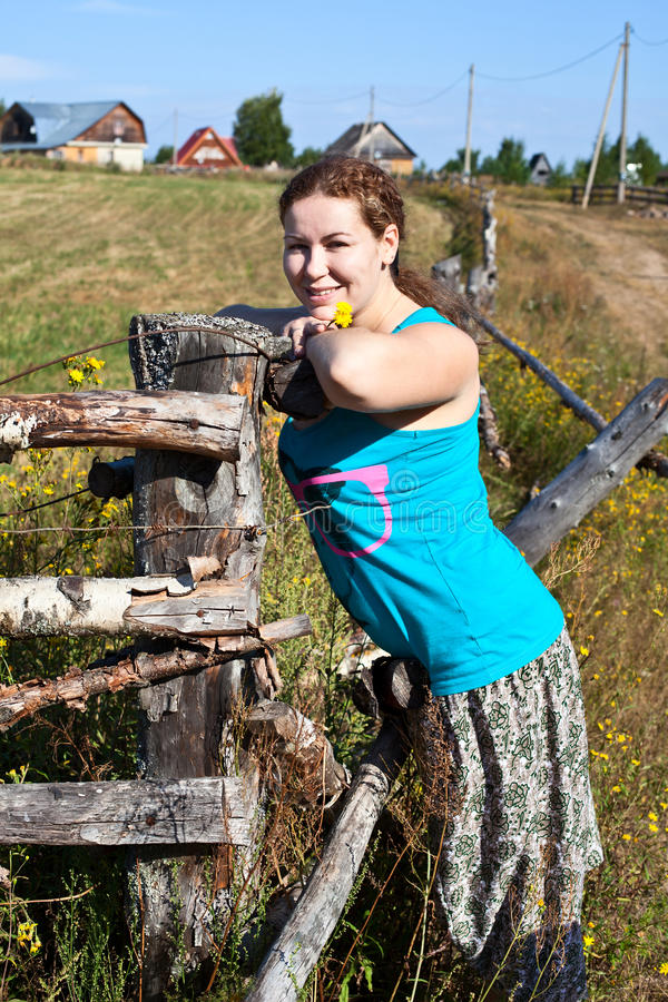 One young countryman woman near village fencege fe stock photos