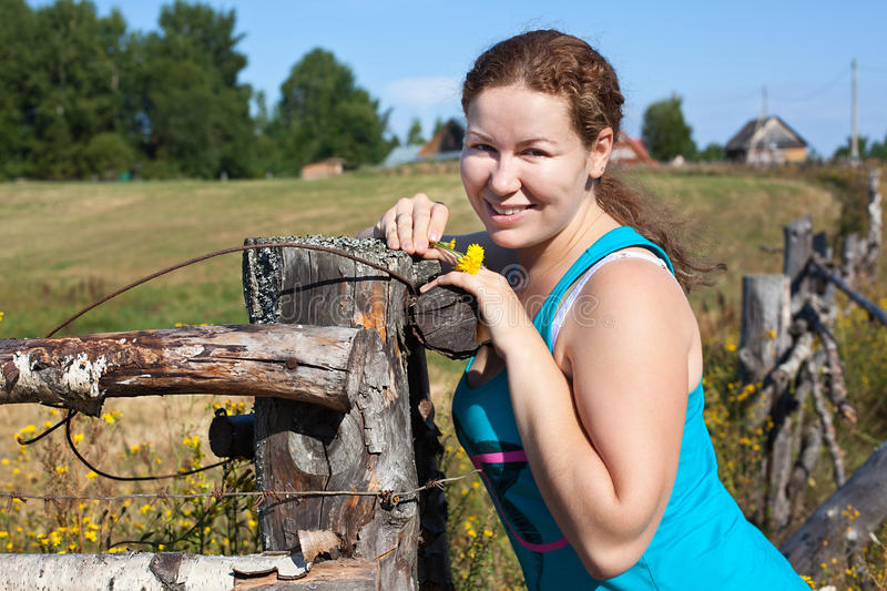 One young countryman woman near village fencege fe royalty free stock photos
