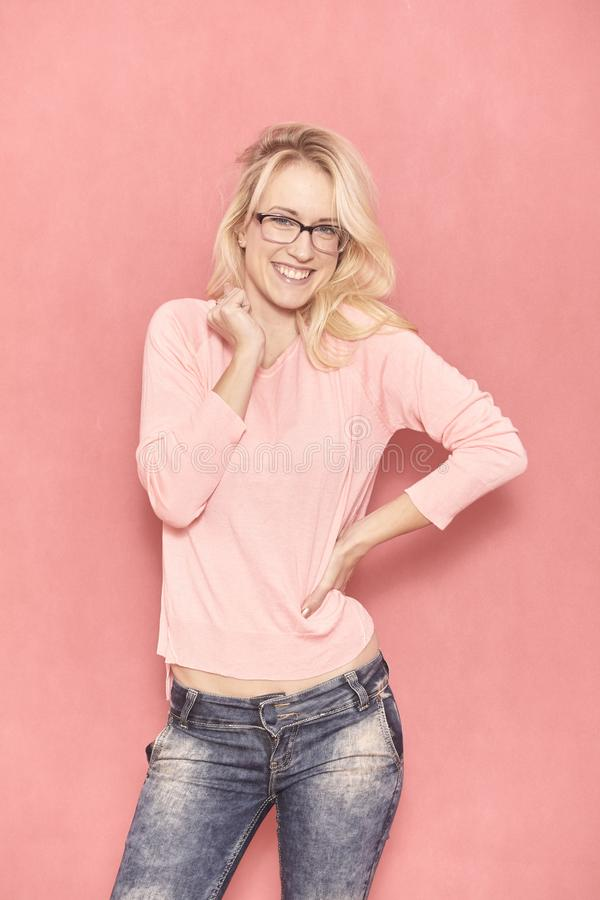 One young cute smiling woman, looking to camera, wearing eyeglasses stock photography