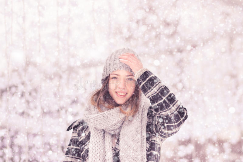 One young cute smiling woman winter clothes hat stock photos