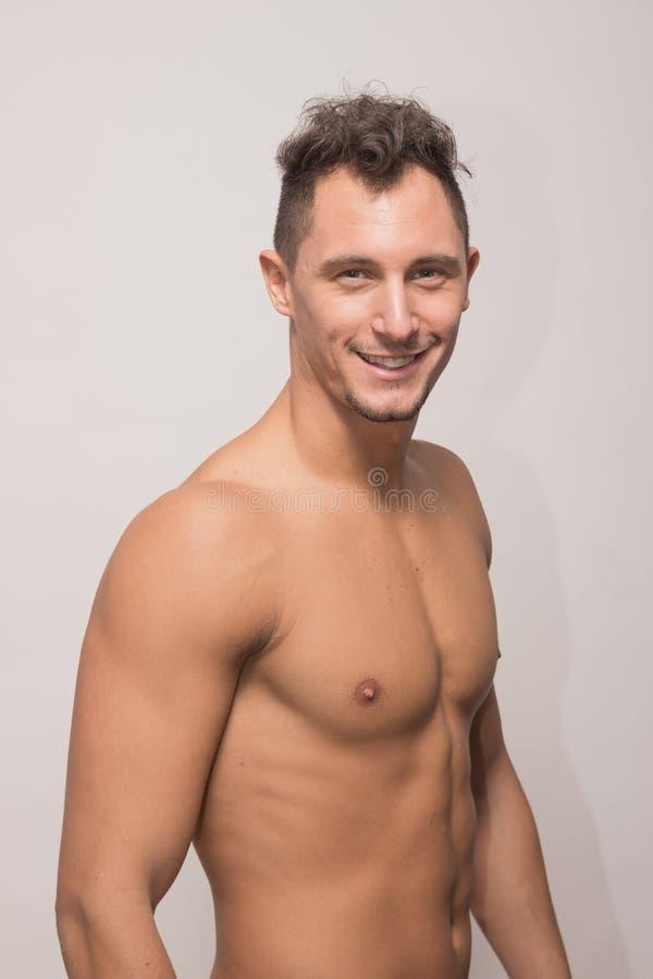 One young man model sideways, polaroid snapshot. One adult young man model sideways, polaroid snapshot, shirtless body muscular, 25 years old stock image