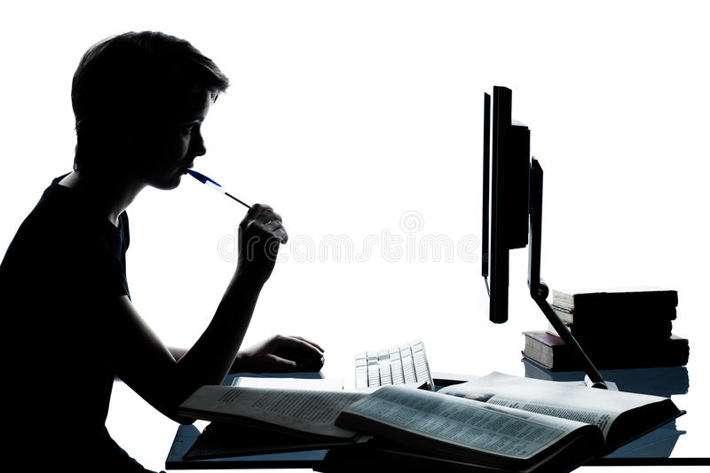 One young teenager boy girl silhouette studying with computer c royalty free stock image