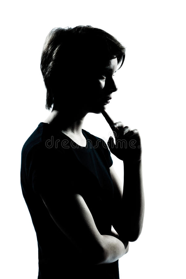 One young teenager boy or girl silhouette thinking. One caucasian young teenager silhouette boy or girl thinking portrait in studio cut out isolated on white stock image