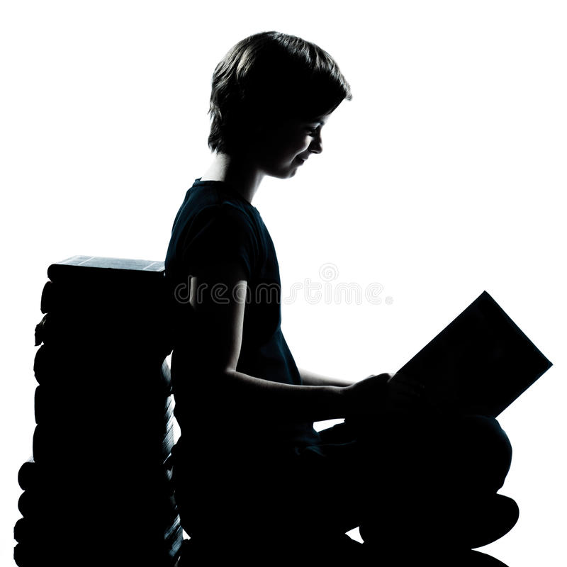 One young teenager silhouette boy or girl reading stock photos