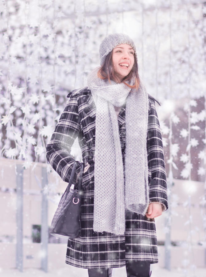 One young woman, coat scarf hat winter laughing stock images