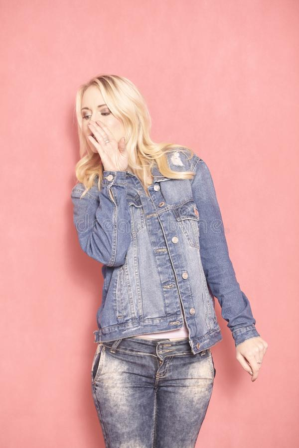 Model whispering secret to side stock photography