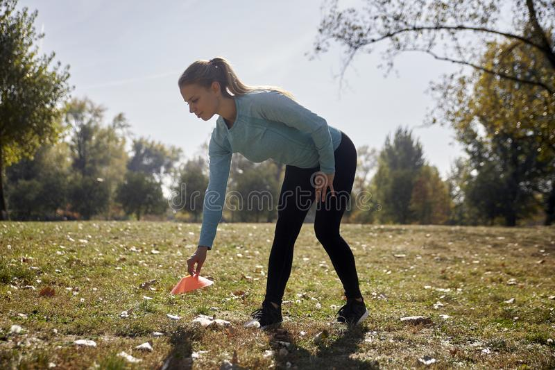 One young woman, 20-29 years old, putting exercise prop, preparing to exercise royalty free stock photography