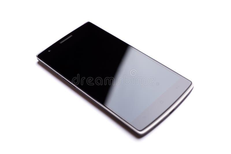 OnePlus在白色背景隔绝的一智能手机前方 免版税库存图片