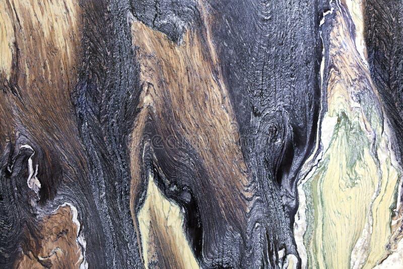 Ongebruikelijke en geheimzinnige bruine, zwarte, groene en witte marmeren textuur Opgepoetste oppervlakte royalty-vrije stock foto's