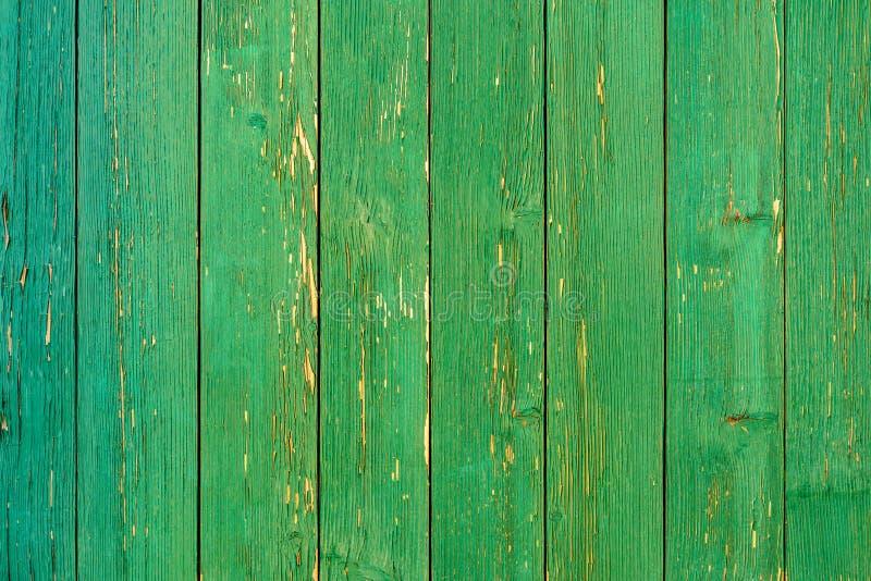 Ongelooflijk mooie oude textuur van een groene houten muur met gebarsten verf stock fotografie