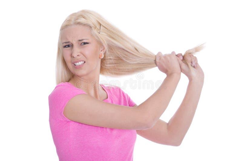 Ongelukkige jonge die vrouw met haarproblemen - over wit worden geïsoleerd stock foto's