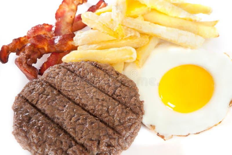 Ongezonde kost met hoge niveaus van calorieën en cholesterol royalty-vrije stock foto's