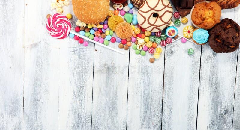 Ongezonde producten voedsel slecht voor cijfer, huid, hart en tanden royalty-vrije stock afbeeldingen