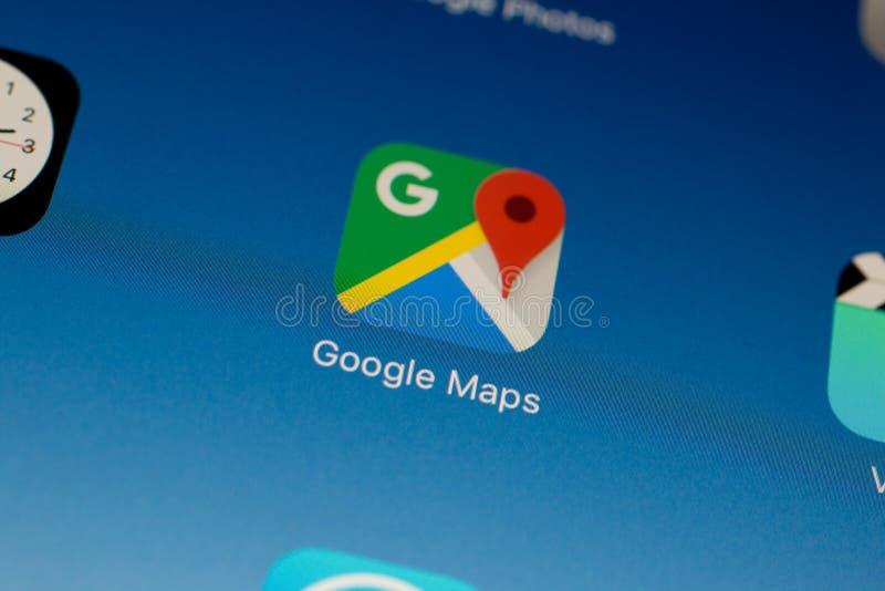 Ongle du pouce/logo d'application de Google Maps sur un air d'iPad photo libre de droits