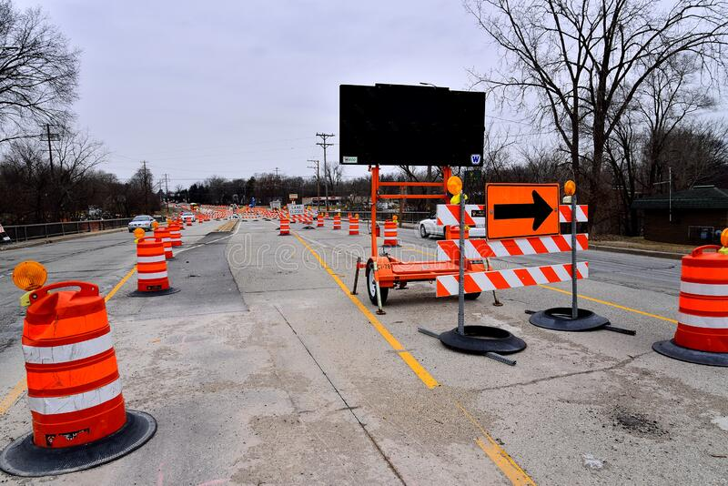 Ongoing Road Construction in Racine Wisconsin. Racine, Wisconsin / USA - January 18, 2019: Road construction continues on Highway 38 and County MM through winter stock image