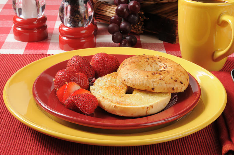 Onion bagel with strawberries royalty free stock photography