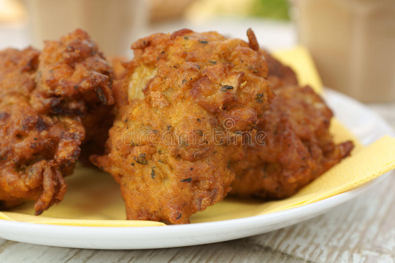 Onion Bhajis. Onion Bhajji or bhaji is a spicy Indian snack of chopped onions fried in dough stock photography