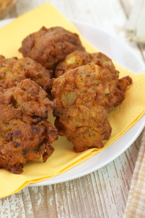 Onion Bhajis. Onion Bhajji or bhaji is a spicy Indian snack of chopped onions fried in dough royalty free stock photo