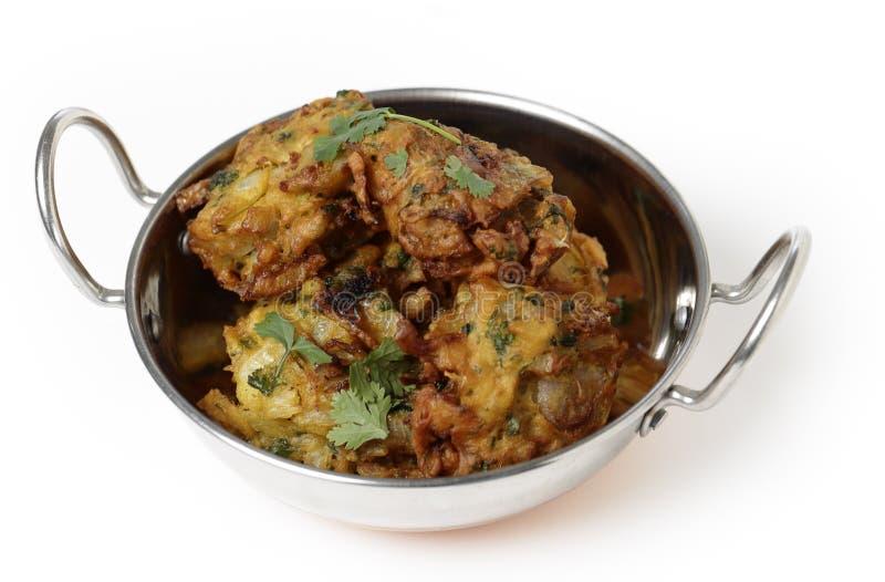 Onion bhajis served in a kadai royalty free stock photography