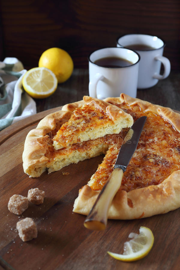 Onion cheese pie and two cup of lemon tea. Jewish cuisine: onion cheese pie and two cup of lemon tea royalty free stock photo