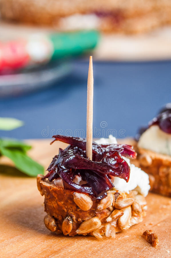 Onion chutney with blue cheese. Served on freshly baked bread. Very strong taste, goes great with wine and olives royalty free stock image