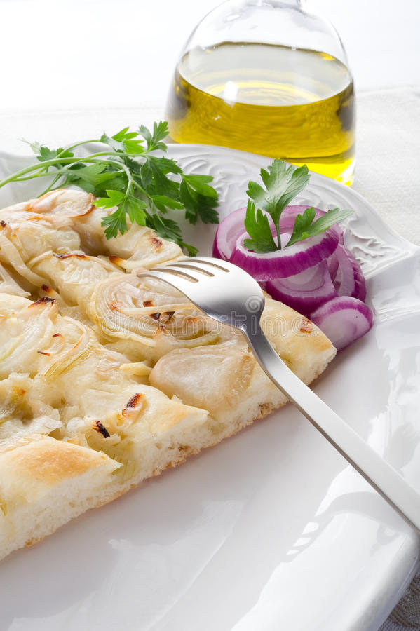 Onion focaccia. Onion white pizza focaccia italian typical bakery product with bottle of olive oil royalty free stock photos