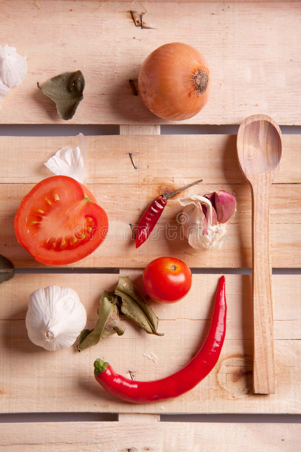 Onion, garlic and pepper. On a wooden desk stock photography