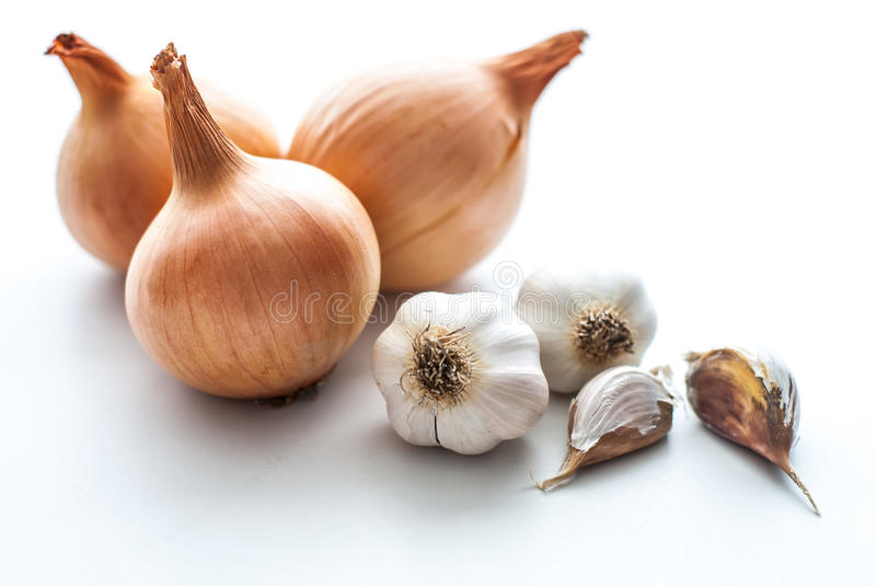 Onion with garlic on white background. royalty free stock photo