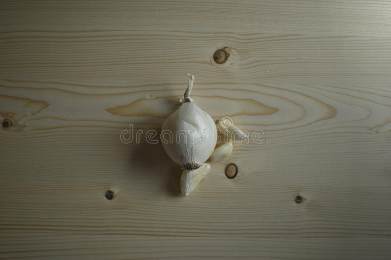 Onion and Garlic. On a wooden table royalty free stock images