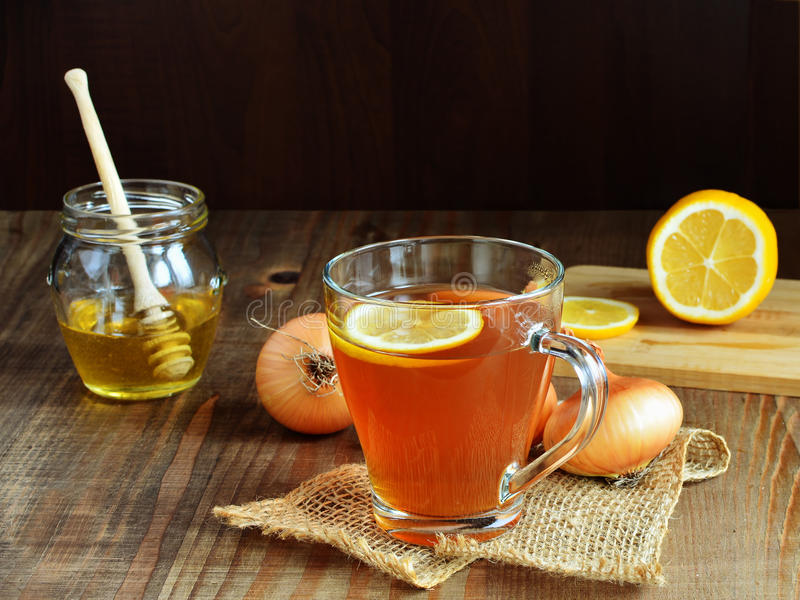 Onion honey lemon tea for colds and cough. In glass mug stock photography