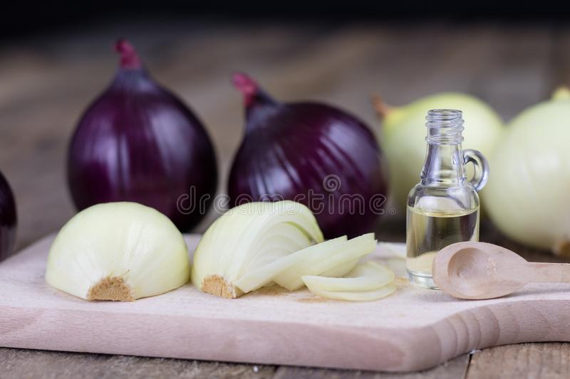 Onion and medicinal juice for a cold. Natural and alternative me. Thods of treatment. Light background stock image