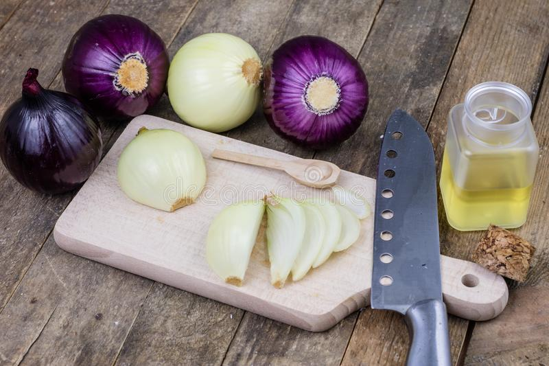 Onion and medicinal juice for a cold. Natural and alternative me. Thods of treatment. Light background stock photos