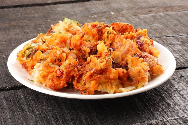 Onion pkkoda. Indian spicy onion pkkoda or pakoras royalty free stock image