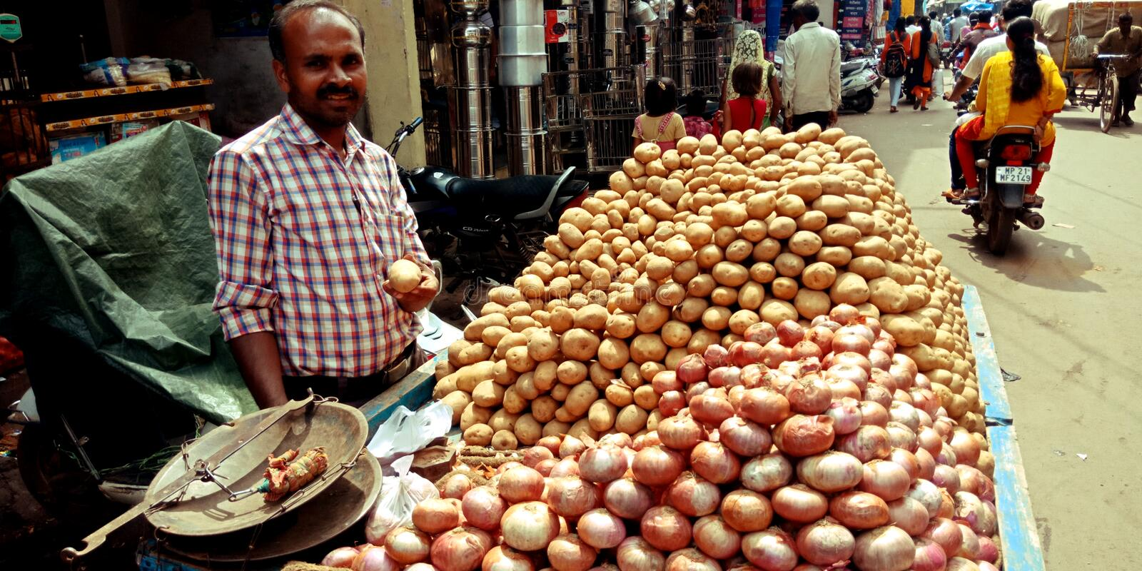 Onion and potato seller at street hand carriage shop royalty free stock image