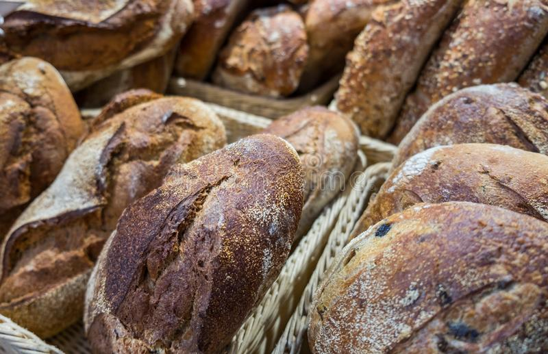 Onion and raisins bread and group of baked goods. For sale at farmers market royalty free stock photography