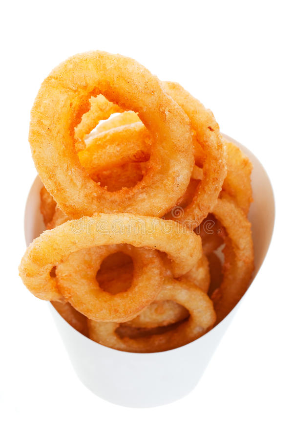 Onion Rings. Golden brown, deep fried onion rings in a generic takeout container. Shot on white background stock photos