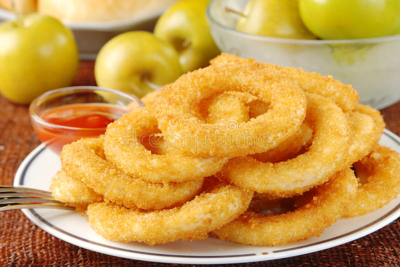 Onion rings. Golden onion rings and ketchup stock photos