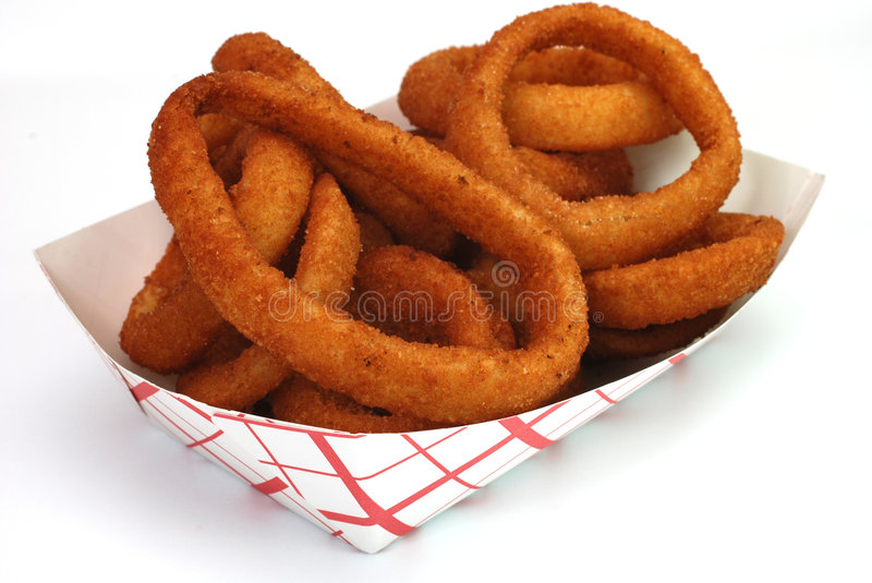 Onion Rings. Fried onion rings in basket isolated on white background royalty free stock images