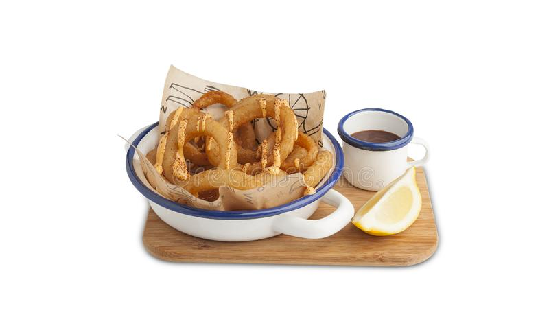 Onion rings with barbecue sauce stock photography