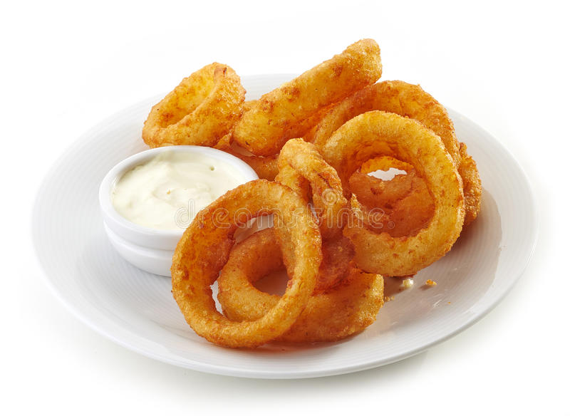 Onion rings and dip sauce. On white plate stock images