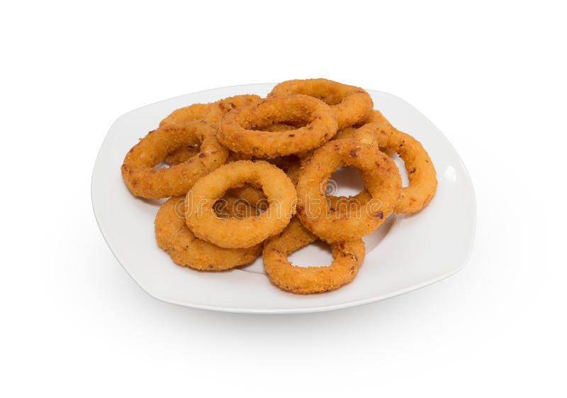 Onion Rings. Entire plate of onion rings over white background royalty free stock photography