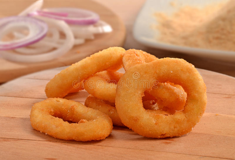 Onion rings. On wood table stock images