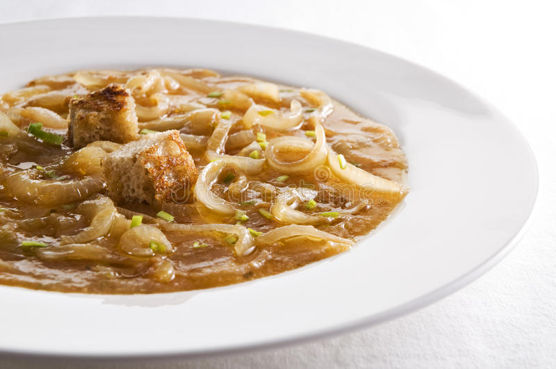 Onion soup. Fresh traditional french onion soup close up stock photography
