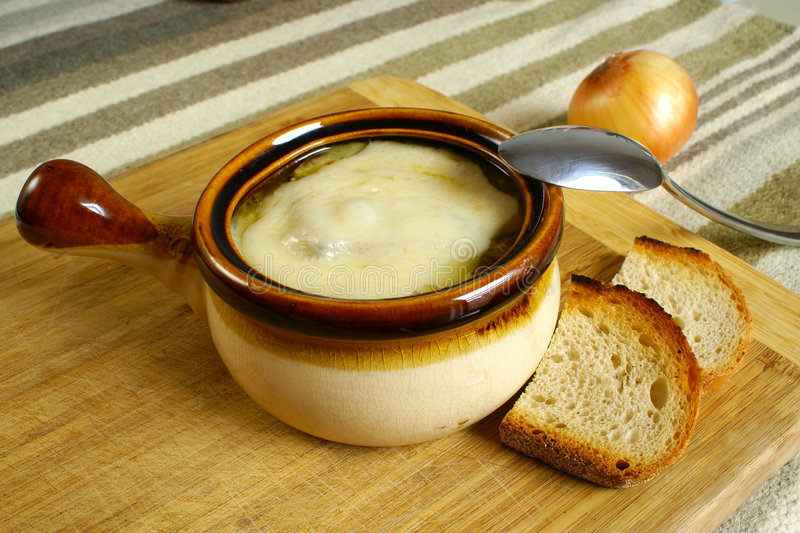 Onion soup. French onion soup with Swiss cheese and bread croutons royalty free stock photography