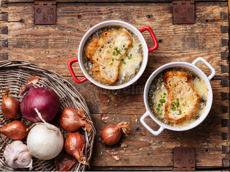 Onion soup. With dried bread and cheddar cheese royalty free stock photography